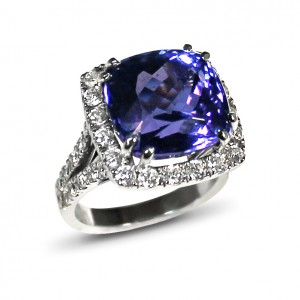 A cushion cut Tanzanite weighing 13 carats mounted with diamonds in 18K white gold
