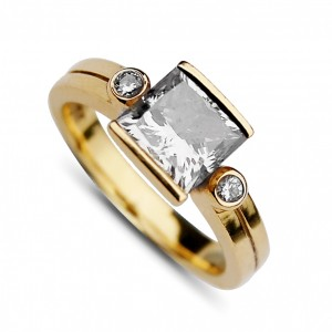 A princess cut diamond  weighing 2 carats, K colour, VS2 clarity. Mounted in 18k yellow gold