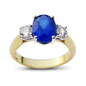 An oval cut Sapphire ring weighing 3 carats with diamonds weighing 1 carat in total , G colour, VS2 clarity, mounted in 18K gold