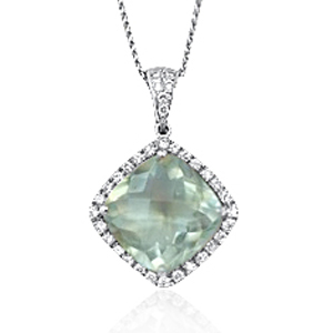 A cushion cut green quartz weighing 10 carats mounted with diamonds in 18K gold