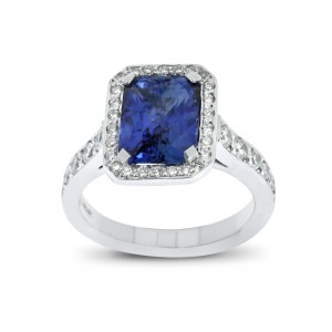 An Emerald cut blue Sapphire weighing 2.77 carats mounted in 18K white gold with diamonds