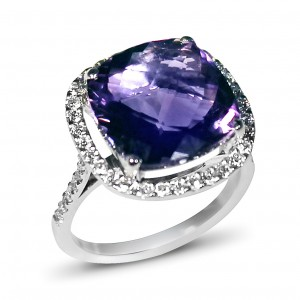 An cushion cut Amethyst weighing 7 carats mounted with diamonds in 18K white gold