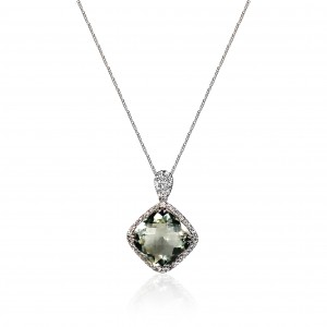 A cushion cut green quartz weighing 7 carats mounted with diamonds in 18K white gold