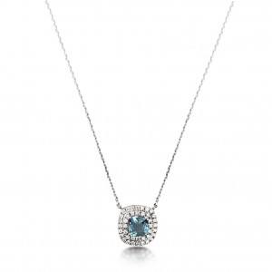 A 0.50 carat cushion cut Aquamarine mounted in 18k white gold with G VS diamonds
