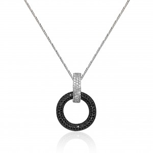 Black and white diamond pendant mounted in 18K white gold