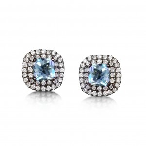 A pair of 18k gold earrings with black rhodium set with cushion cut Aquamarines and diamonds.