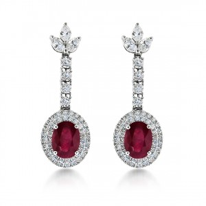A Pair of unheated oval rubies weighing 2.50 carats each mounted in Platinum with diamonds