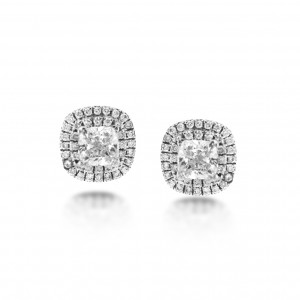 A pair of cushion cut diamonds weighing 1 carat mounted in 18k white gold with G VS diamonds