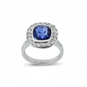 A 3.17 carat Cushion cut Sapphire mounted in 18K white gold with diamonds