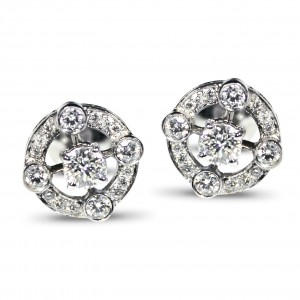 A pair of diamonds studs with 1.20 carats of diamonds, G VS quality mounted in 18K white gold