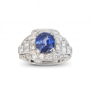 A 2.96 carat cushion cut Sapphire mounted with G VS diamonds in 18K white gold