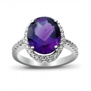 An oval Amethyst weighing 7 carats with micro set diamonds mounted in 18K white gold