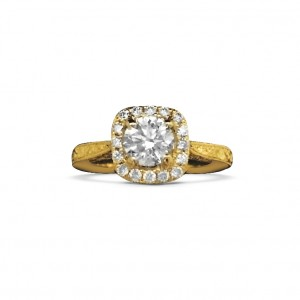 A round brilliant diamond set in an antique style engagement ring