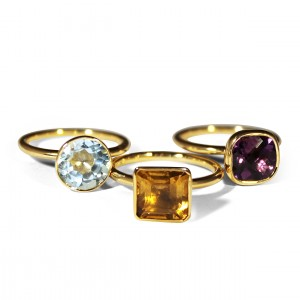 3 Stacking rings with a Topaz, Citrine and Amethyst mounted in 18K yellow gold
