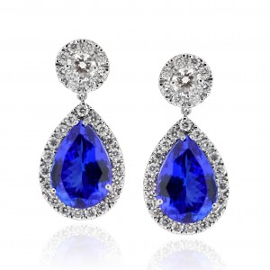 A pair of Tanzanite earrings weighing 6 carats each mounted with G VS diamonds in Platinum