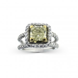 A 2.04 carat Radiant cut  fancy yellow diamond mounted with Pave diamonds in 18K white gold