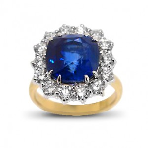 A cushion cut Sapphire weighing 6.97 carats set with diamonds in 18K white and yellow gold