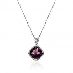A cushion cut Amethyst weighing 7 carats mounted with diamonds in 18K white gold