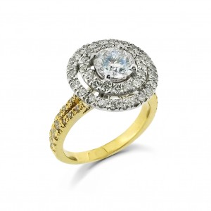 A round diamond with two rows of G VS diamonds mounted in 18K gold with a split shank
