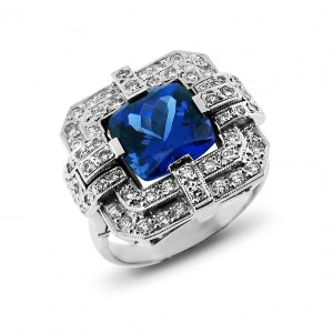 A cushion cut Tanzanite weighing 6 carats set with diamonds in 18K white gold
