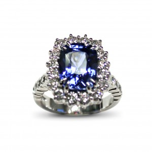 A 4.52 carat cushion cut Sapphire mounted with G VS diamonds in 18K white gold