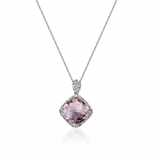 A cushion cut pink Amethyst weighing 7 carats mounted with diamonds in 18K white gold
