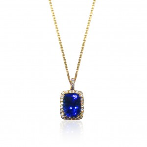 A cushion cut Tanzanite weighing 5 carats mounted with diamonds in 18K gold