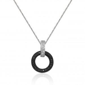 Black and white diamond pendant mounted in 18K white gold