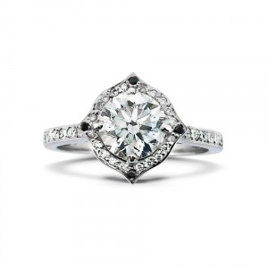 A 1.03 carat diamond ring mounted in 18K white gold with black and white diamonds