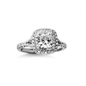 A 1.80 carat cushion cut diamond mounted in 18k white gold with diamonds