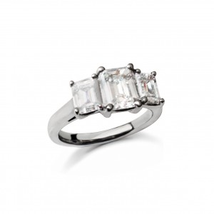 An Emerald cut 3 stone ring mounted in Platinum weighing 1.95 carats G colour VS clarity
