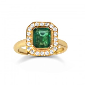 An Emerald cut Emerald engagement ring mounted with diamonds in 18k yellow gold