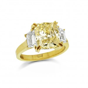 A Cushion cut yellow diamond with white tapered baguette diamonds.