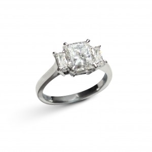 A 1.50 carat G VS1 Radiant cut diamond with faceted Baguettes mounted in 18K white gold
